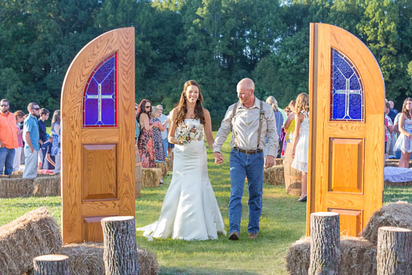 Rustic Outdoor Wedding of Jody and Larry in the Aisle