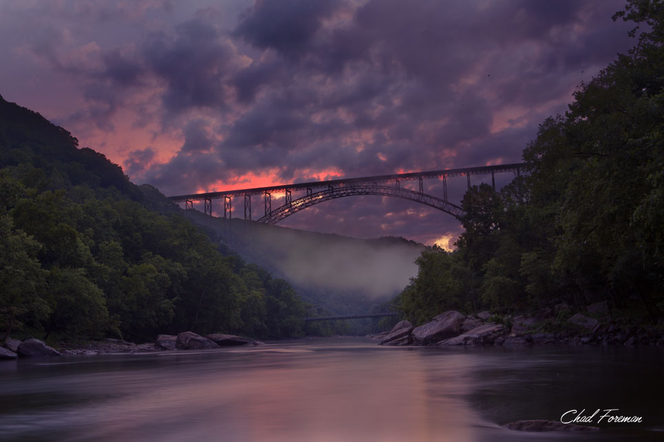 New River Gorge Bridge sunset after rain.