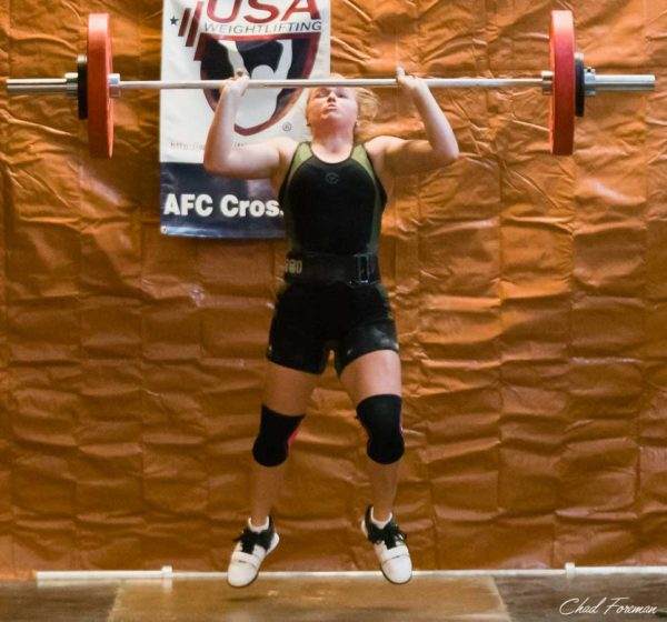 This Olympic Weightlifting competitor has so much power, she comes off the ground amid her snatch movement