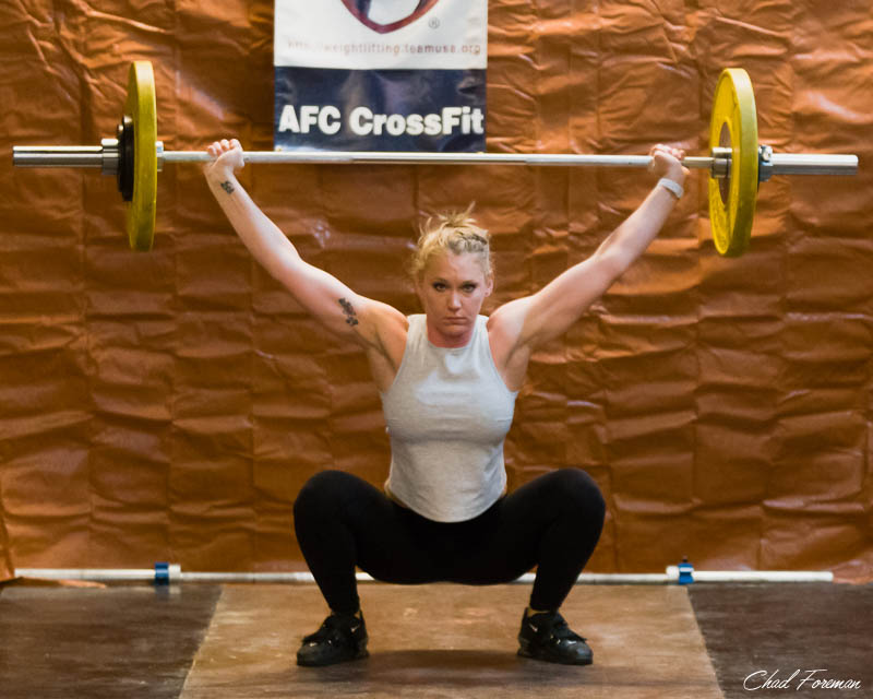 CrossFit Coach, Kristen is always in perfect form. Here she is in her Snatch movement during the meet.