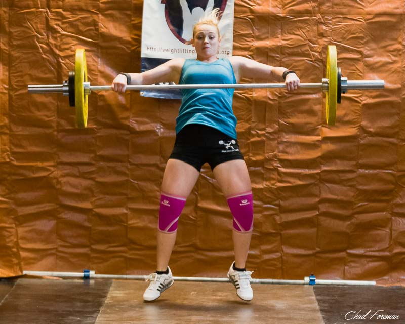 This olympic weightlifter expresses power and control during her lift