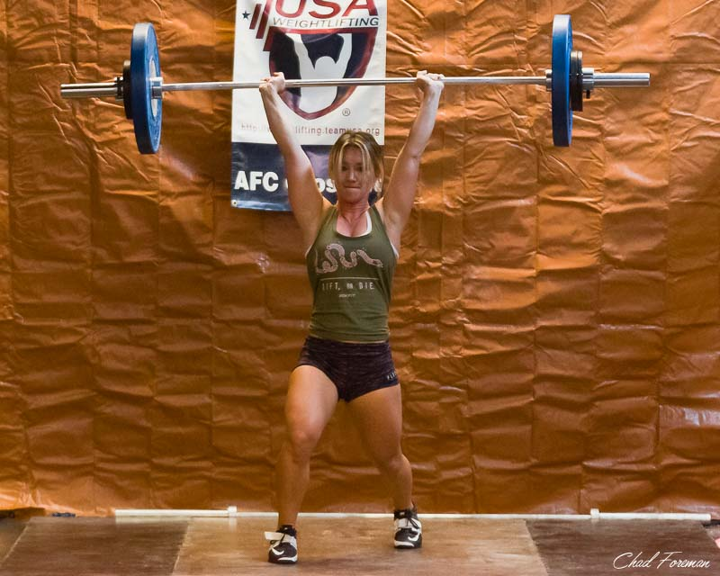 Coach Cary looks strong during her Clean and Jerk lift at the meet.