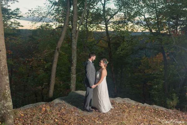 Wedding portrait of bride and groom along the New River Gorge.