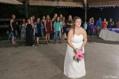 Bride tossing the bouquet at the reception