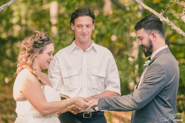 Bride places wedding ring placed on groom