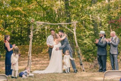 Ring bearer is too excited at wedding kiss
