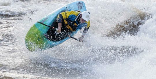 adventure sports photography freestyle kayaker
