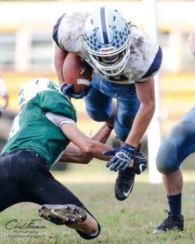 sports photography high flying halfback football