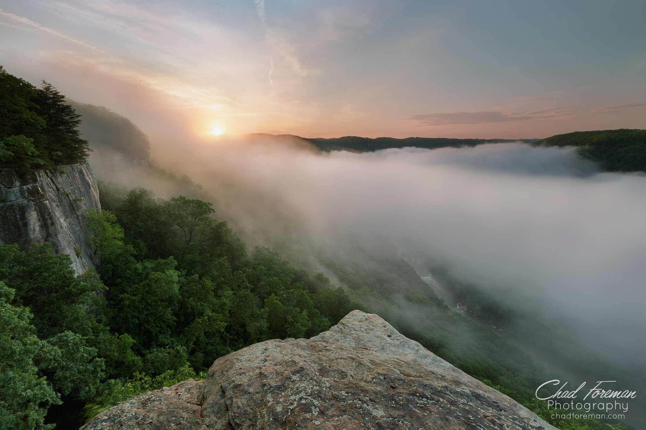 Clouds in the New River Gorge hover above the river